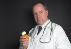 Doctor with Pills Stock Photo