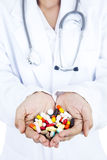 A doctor with pills and capsules Stock Photography