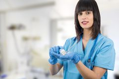 Doctor with pills in hand closeup. Woman doctor with pills in hand closeup royalty free stock photography