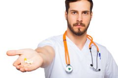 Doctor with pills in hand Stock Image