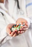 Doctor with pills in her hands Royalty Free Stock Images