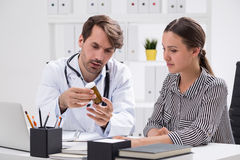 Doctor with pills Stock Image