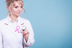 Doctor with pink cancer ribbon Royalty Free Stock Photo