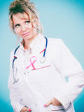Doctor with pink cancer ribbon Stock Image