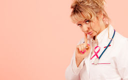 Doctor with pink cancer ribbon Royalty Free Stock Photography