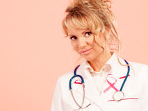 Doctor with pink cancer ribbon Royalty Free Stock Image