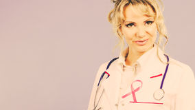 Doctor with pink cancer ribbon Stock Photo