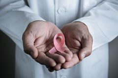 Doctor with a pink ribbon royalty free stock image