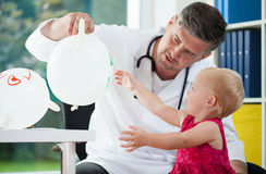 Doctor play with child Royalty Free Stock Photography