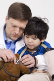 Doctor playing with disabled little boy Stock Photography