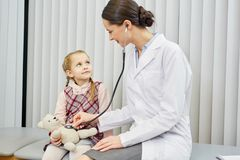 Little girl visiting a doctor Royalty Free Stock Image
