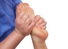 The doctor-podiatrist does an examination and massage of the patient`s foot. In the clinic Royalty Free Stock Image