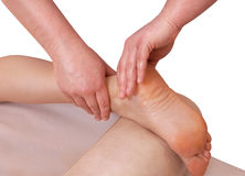 The doctor-podiatrist does an examination and massage. Of the patient`s foot in the clinic Stock Photos