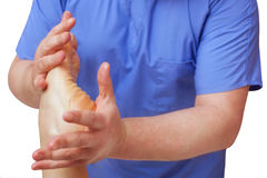 The doctor-podiatrist does an examination and massage of the patient`s foot. In the clinic Royalty Free Stock Photography