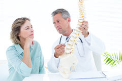 Doctor pointing anatomical spine Royalty Free Stock Photos