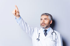 Doctor pointing away. Royalty Free Stock Photos