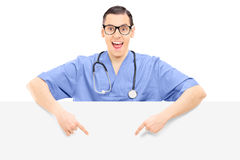 Doctor pointing on a blank panel Royalty Free Stock Photo