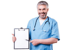 Doctor pointing clipboard. Stock Photos