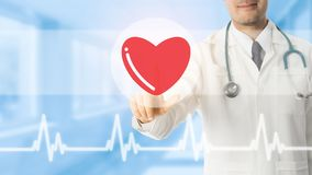 Doctor pointing at heart icon on blue background