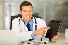 Doctor pointing tablet computer Royalty Free Stock Photos