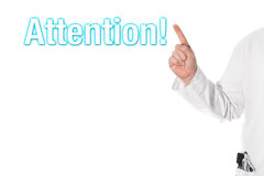Doctor pointing at a title (attention) Stock Images