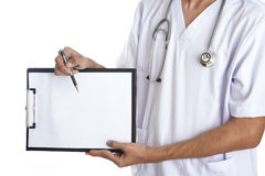 Doctor pointing to a blank paper Stock Image