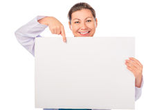 Doctor pointing to empty blank poster Stock Image