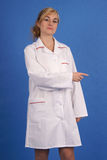 Doctor pointing to her left Stock Photo