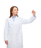 Doctor pointing to something or pressing button Stock Photo