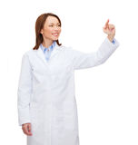 Doctor pointing to something or pressing button Royalty Free Stock Photography