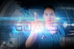 Doctor pointing to the word goals Stock Image