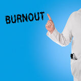 Doctor pointint at the word Burnout Stock Images