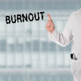 Doctor pointint at the word Burnout Stock Photo