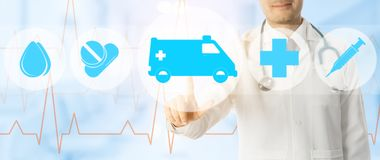 Doctor points at ambulance and emergency icon. Emergency Service - Doctor points at ambulance and emergency medicine icon on medical background Royalty Free Stock Photo