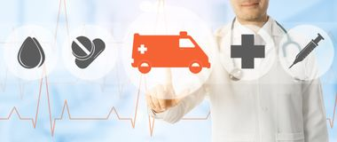 Doctor points at ambulance and emergency icon. Emergency Service - Doctor points at ambulance and emergency medicine icon on medical background Royalty Free Stock Image