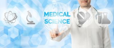 Doctor Points at MEDICAL SCIENCE with Medical Icon. Medical Research Concept - Doctor points at MEDICAL SCIENCE with icons showing symbol of technology, hospital stock illustration