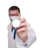 Doctor points stethoscope at camera stock image