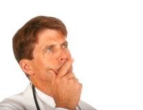 Doctor Pondering a Problem. Doctor Studying over a Problem, Isolated on White Background stock photo