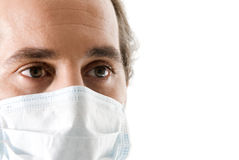 Doctor portrait. Adult doctor with mask on white background Stock Photography