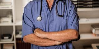 Doctor posing in his office Royalty Free Stock Photos