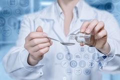 A doctor is pouring some medicine into the spoon royalty free stock images