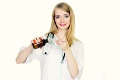 Doctor pouring syrup Stock Photos