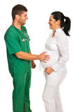 Doctor and pregnant woman Stock Image