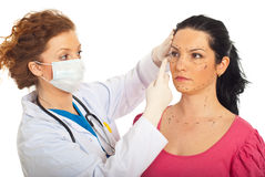 Doctor prepare woman for plastic surgery Stock Photo