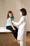 Doctor Prepares Young Patient's Arm-Vertical Stock Images