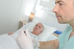 Doctor preparing anesthesia for surgery. Doctor is preparing anesthesia for surgery Royalty Free Stock Photo