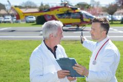 Doctor preparing in helicopter emergency medical service Stock Images