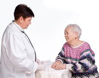 Doctor preparing injection for old woman Royalty Free Stock Image