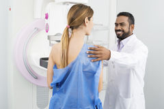 Doctor Preparing Patient For Mammogram Test royalty free stock photo