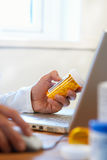 Doctor preparing prescription stock images